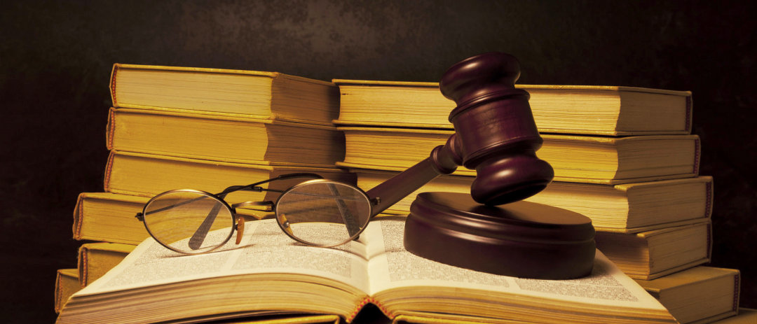 gavel and glasses on top of a book